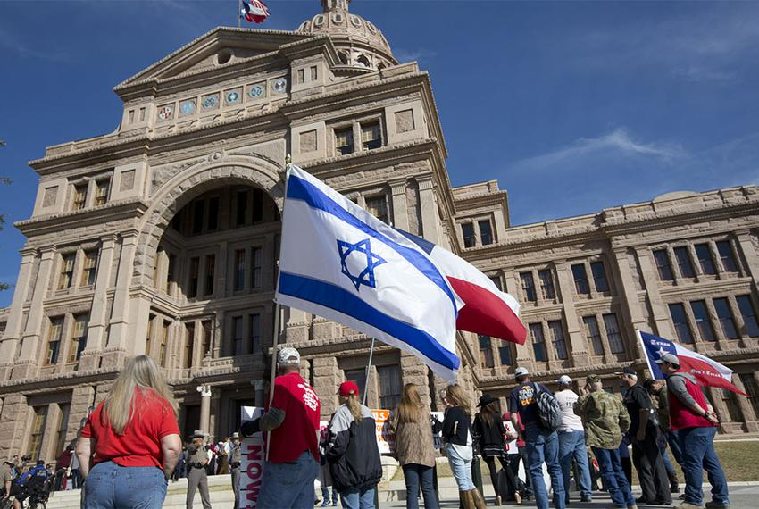 A small but vocal group of protesters look on as Texas Muslim Capitol Day ceremonies get underway on Jan. 29, 2015.