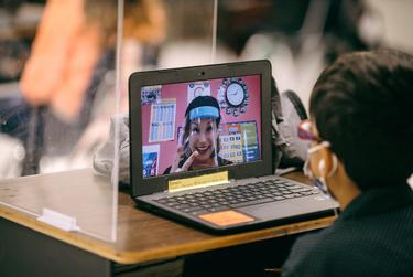 Students in Abigail Boyett's third grade class use Zoom to stay in sync with her teaching, as well as with the remainder of their classmates that attend class from home.