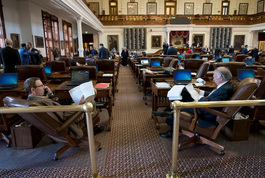 Reps. Byron Cook, left and Todd Hunter, right, on the House floor of the Texas Capitol on April 27, 2017.