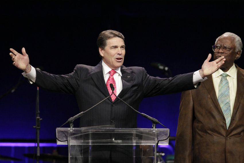 """Governor Rick Perry addresses """"The Response"""" at Reliant Stadium in Houston on August 6, 2011."""