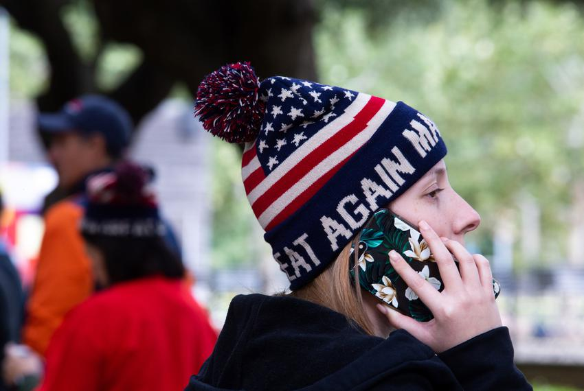 Shelby Nemeth, 23, sports a Make America Great Again beanie while waiting in line to get into the rally, in Houston on Oct. …