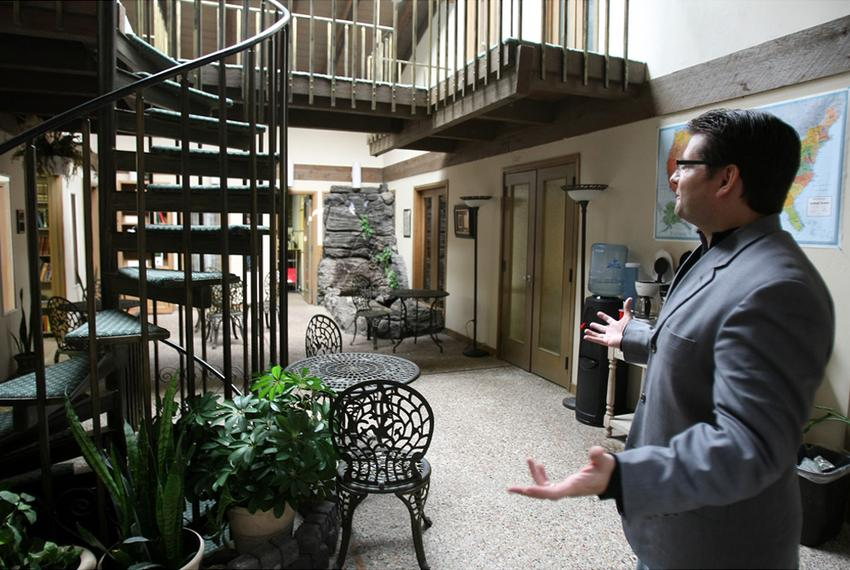 Christopher Cone, president of Tyndale Theological Seminary & Biblical Institute, shows the atrium of their Hurst, Texas loc…
