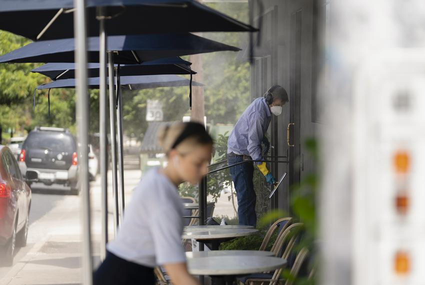 Employees at an Austin restaurant work outdoors on July 19, 2021.