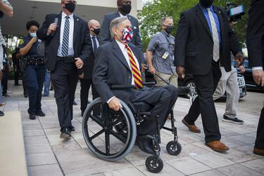 Gov. Greg Abbott exits the George Floyd public memorial service at the Fountain of Praise Church in Houston on June 8, 2020.