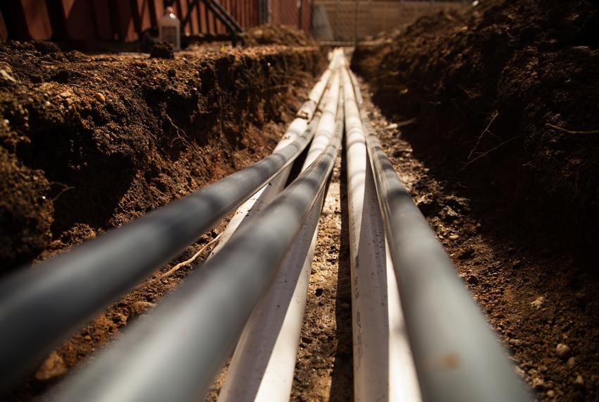 Pipes lie in a trench inside the Regency Apartment complex in Austin on Feb. 24, 2021.
