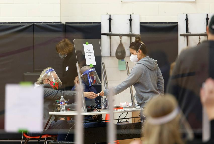 People vote inside the gym at the Metropolitan Multi-Services Center in Houston on Nov. 3, 2020.