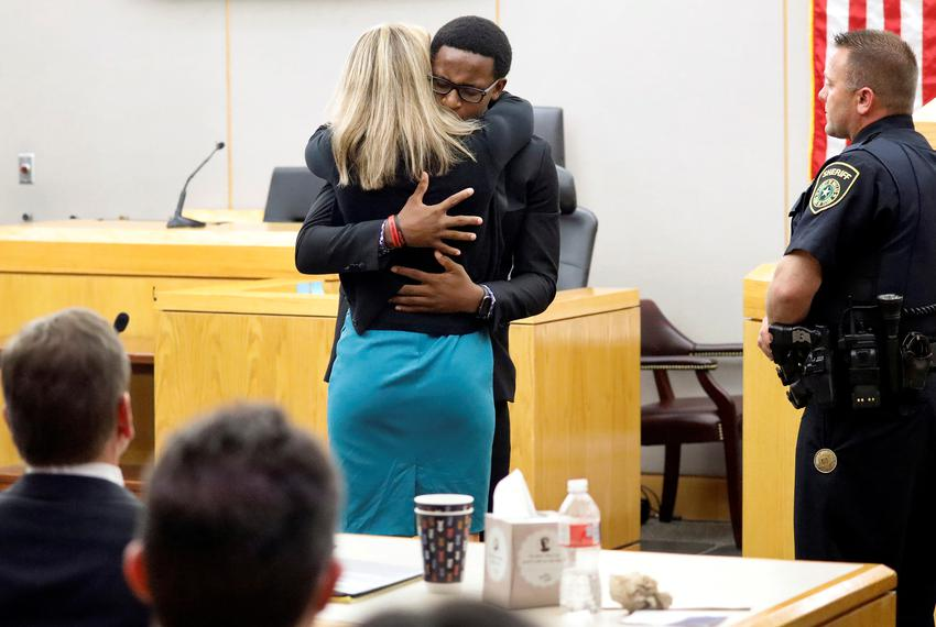 Botham Jean's younger brother Brandt Jean hugs former Dallas police officer Amber Guyger after delivering his impact state...