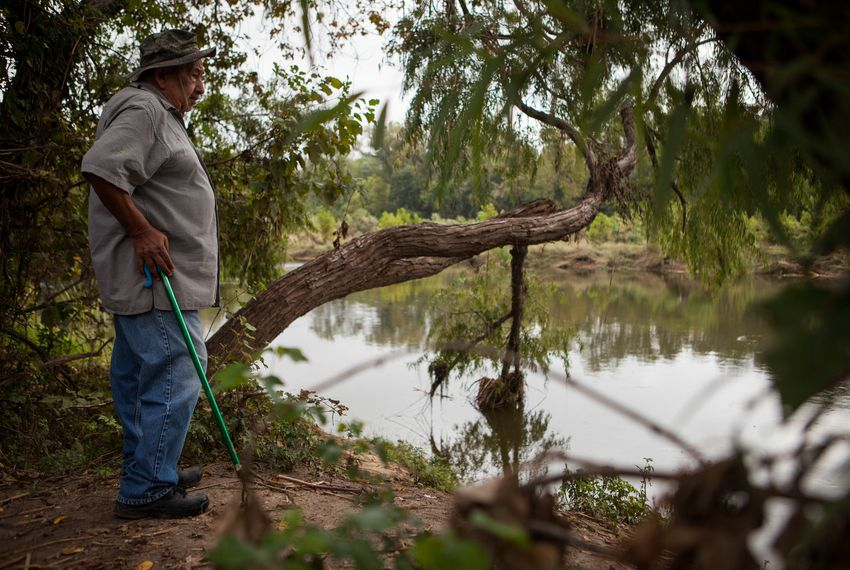Pete Matamoros, 81, walks near the Colorado River under U.S. Highway 183 at the Colorado River Wildlife Sanctuary in Austin, picking up trash as a form of exercise.