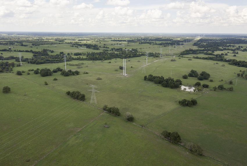 A proposed high-speed rail would be built along existing power lines for much of its length between Dallas and Houston. But many project opponents say a state agency should be involved in a private company's use of eminent domain.