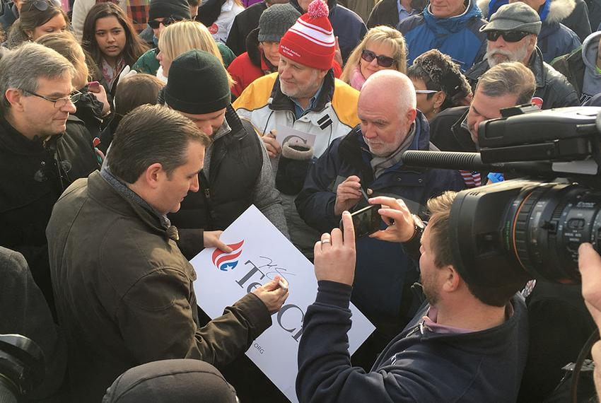 Ted Cruz signs a poster Tuesday after a rally in Hudson, New Hampshire. The Republican presidential candidate returned to th…