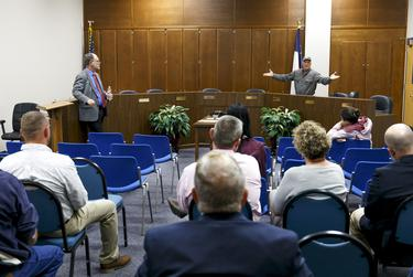 Shepherd ISD board trustee Michael Courvelle speaks at the district administration building after a meeting scheduled by the Texas Education Agency was canceled on Monday.