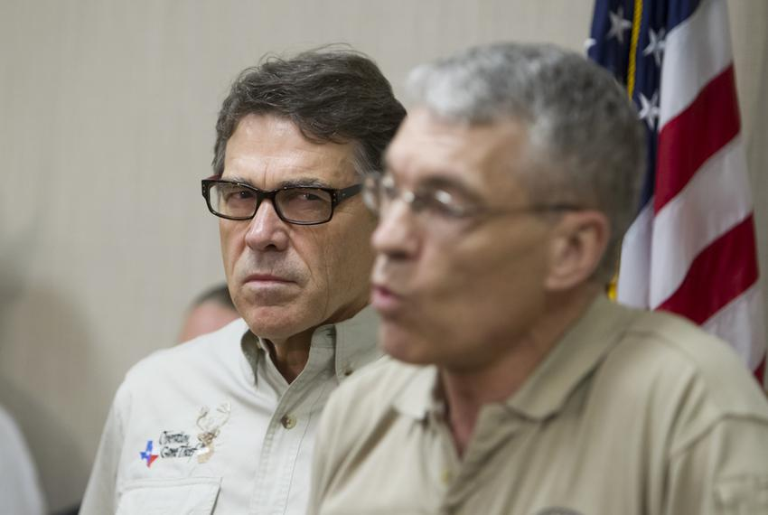 Gov. Perry and DPS Director Steve McCraw, speak to media following a tour to a federal facility housing unaccompanied alien …