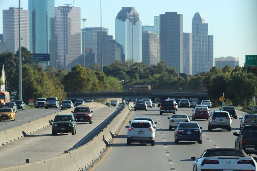 Cars approach downtown Houston on southbound Interstate 45.
