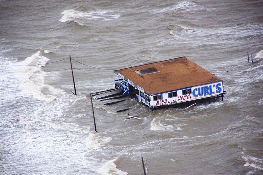 Joint Task Force-129 crew, Jolly 92, flies over the storm surge that overtook the Bolivar Peninsula bridge near Galveston, Texas, Sept. 12, 2008.