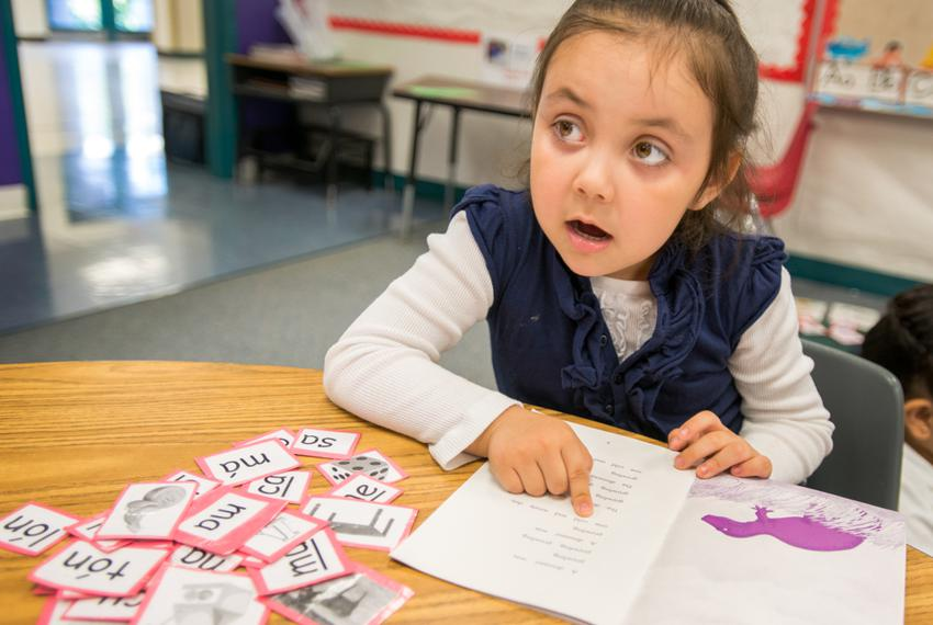An early reader looks to teacher, Josefina Pineda, in her Pre-K at the Dallas Independent School District elementary school …
