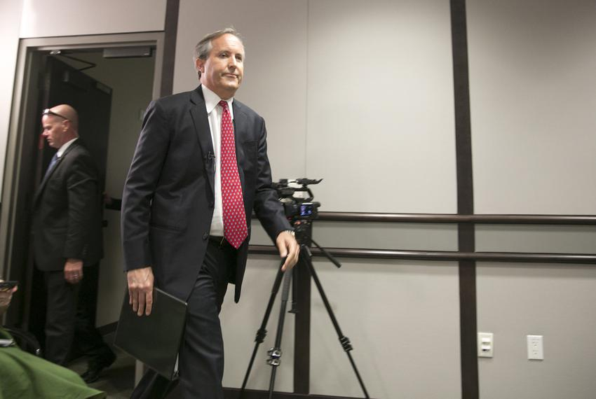 Texas Attorney General Ken Paxton, enters room where he will announce information on a lawsuit filed in U.S District Court a…