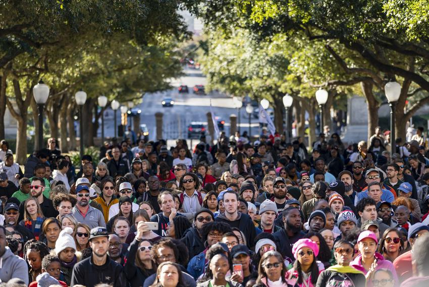 Crowds listen to speakers as part of the Martin Luther King Day celebrations on the South lawn of the Texas State Capitol ...