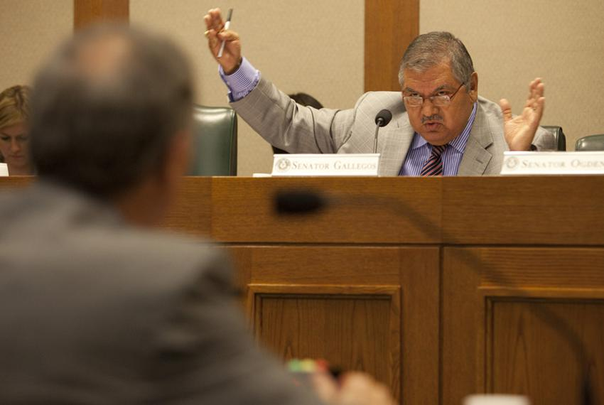 State Sen. Mario Gallegos, Jr., D-Houston,  gestures at the Senate Committee on Education on July 20, 2010.