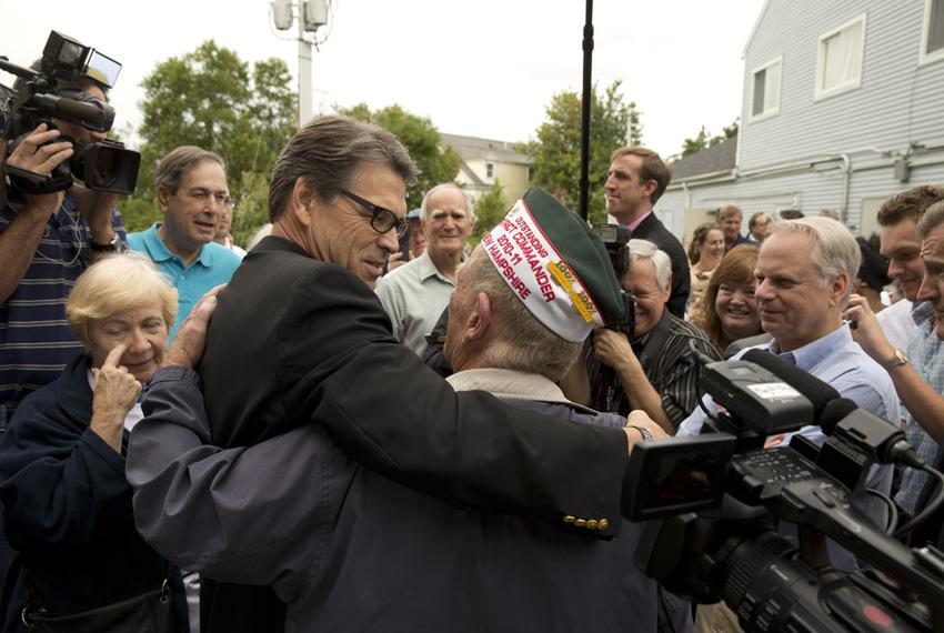 World War II veteran Bob Graham and Texas Gov. Rick Perry embrace at a GOP event in Stratham, N.H. on Saturday.