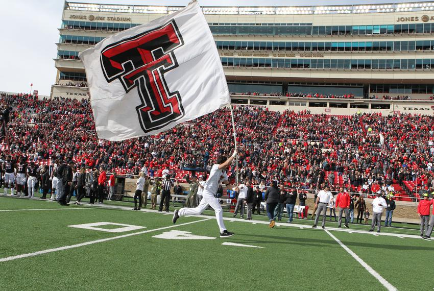 A Texas Tech Red Raiders cheerleader enters the field before a game against the Texas Christian Horned Frogs at Jones AT&T S…