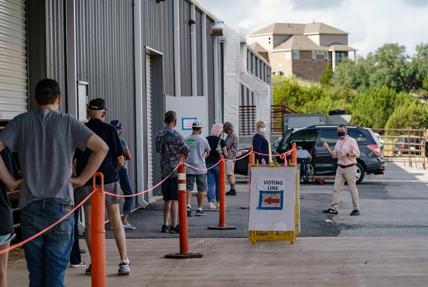 Voters wait in line to cast their ballot at the Dripping Springs Ranch Park in Dripping Springs during early voting in Octob…