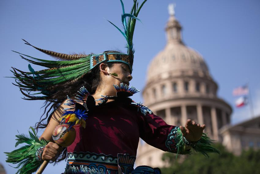 San Antonio resident Rosie Torres perform a Danza Mexica prayer offering on the Capitol South Lawn on May 22, 2019 as part o…
