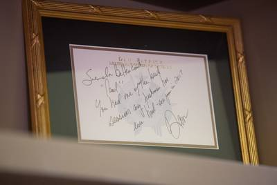 A framed note from Lieutenant Gov. Dan Patrick sits on a shelf in State Sen. Paul Bettencourt's office in the Capitol buidling in Austin on Feb. 13, 2019.