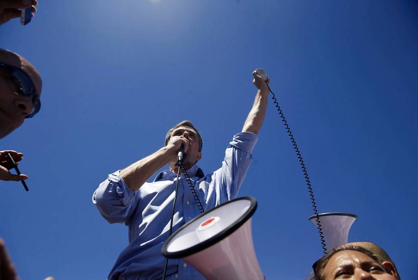 U.S. Rep. Beto O'Rourke, D-El Paso, speaks to the crowd marching on the tent city where children separated from their pare...