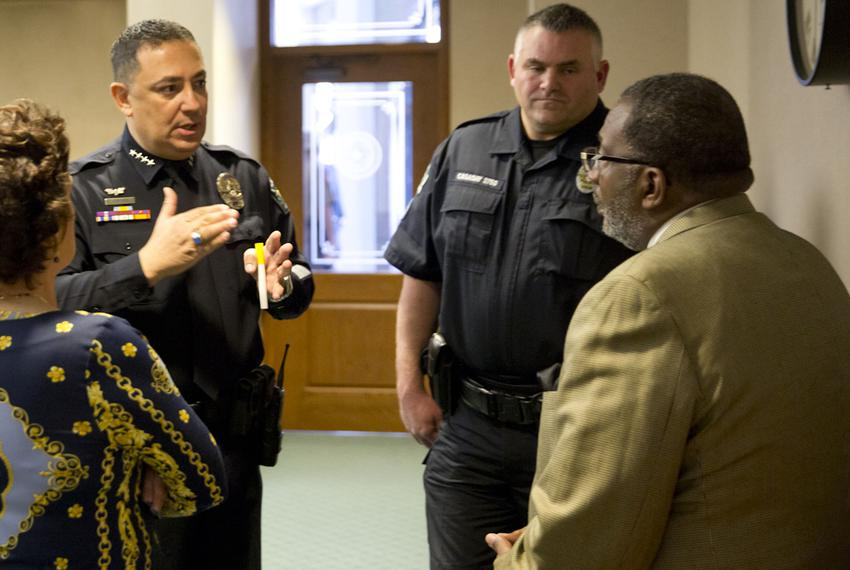 Austin Police Chief Art Acevedo and Austin Police Association President Kenneth Casaday speak with state Sen. Royce West, ...