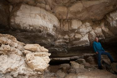 Douglas Meyer, the Devils River project manager for the Nature Conservancy's Dolan Falls Preserve, stands in a large cave at the preserve. Many caves on the preserve served as shelter for indigenous tribes that used to inhabit this area.