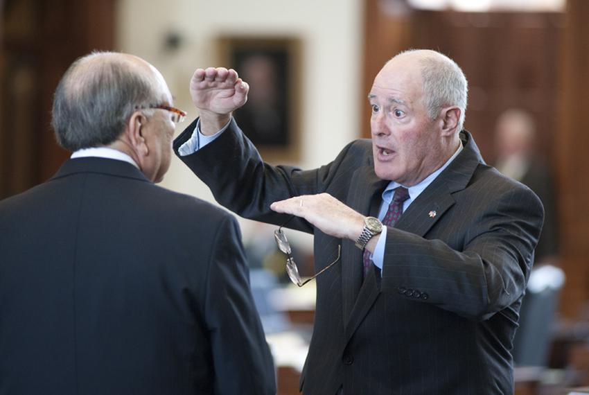 State Sen. Kel Seliger (r), R-Amarillo, explains an issue to Sen Juan Hinojosa (l), D-McAllen, on April 18, 2011.