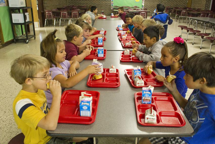 Elementary school students eat breakfast to start the day at Paint Creek school in Haskell County, Texas on September 22, ...