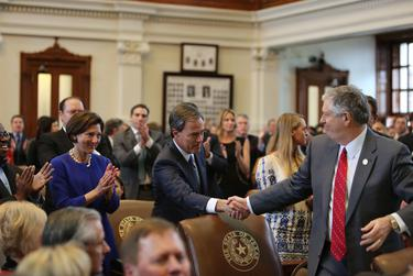 House Speaker Joe Straus shakes hands with state Rep. Paul Workman, R-Austin, on the first day of the 84th Legislative Session.