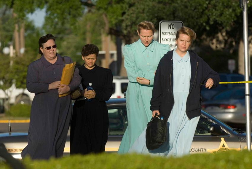 FLDS sect members arrive at the Tom Green County Courthouse in 2008 for a court hearing on hundreds of children taken into s…