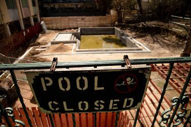 An out-of-use swimming pool behind the Regency Apartment complex in Austin on Feb. 24, 2021.