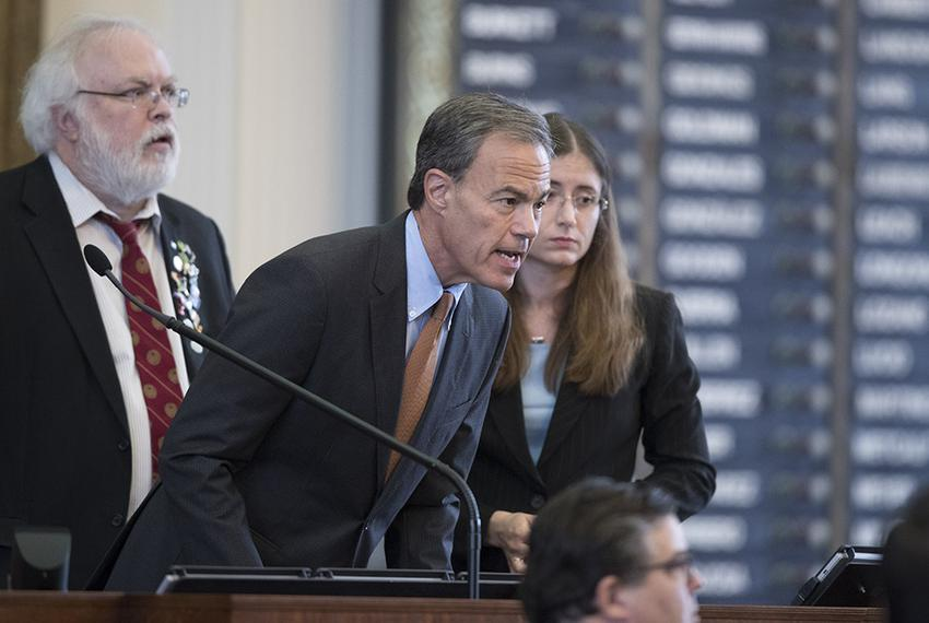 House Speaker Joe Straus questions members during a break in debate of House Bill 214 on August 8, 2017.  The bill would l...