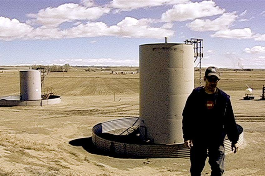 "Josh Fox, creator of ""Gasland,"" stands in a Wyoming gas field."
