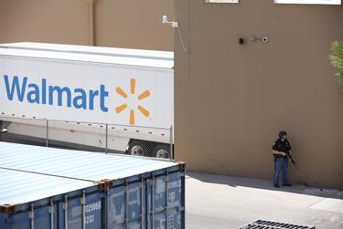 A lone policeman outside the WalMart in El Paso where a mass shooting took place on Saturday, August 3, 2019.