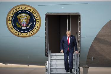 President Donald Trump exits Air Force One at Austin-Bergstrom Airport where he visits an Apple campus in Austin on Nov. 20, 2019.