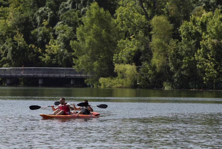 Two men kayak at Lady Bird Lake on Saturday, July 4, 2020 in Austin.