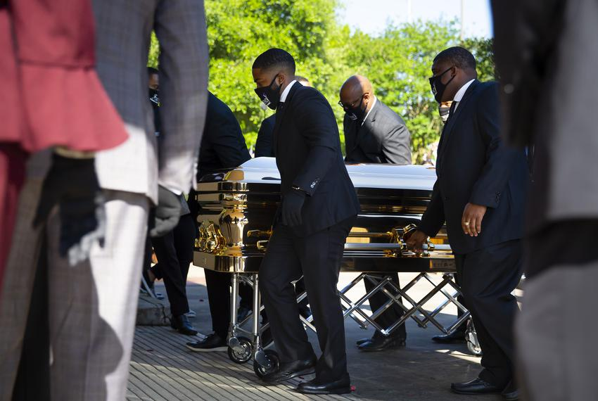 A gold casket containing the body of George Floyd arrives for a public memorial service at the Fountain of Praise Church in …
