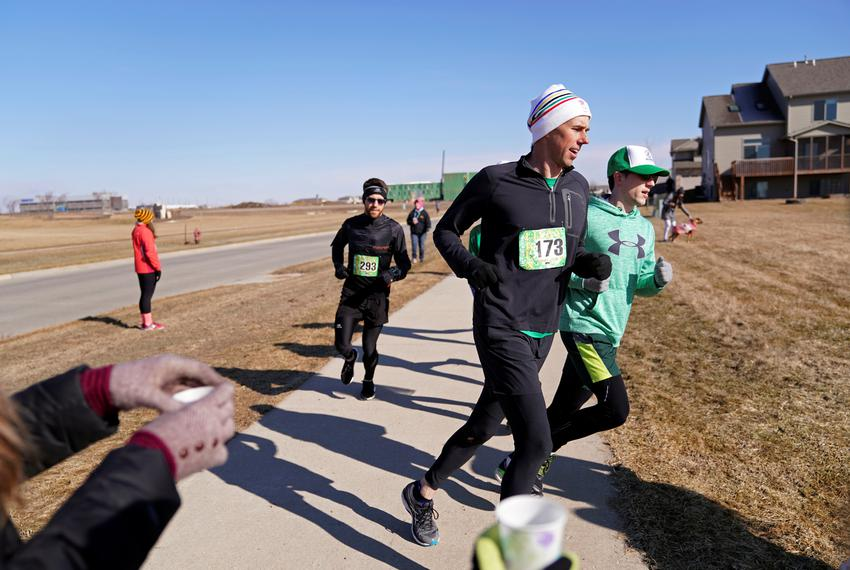 Democratic 2020 presidential candidate Beto O'Rourke, 46, runs a St. Patrick's Day 5K race during a three-day road trip ac...