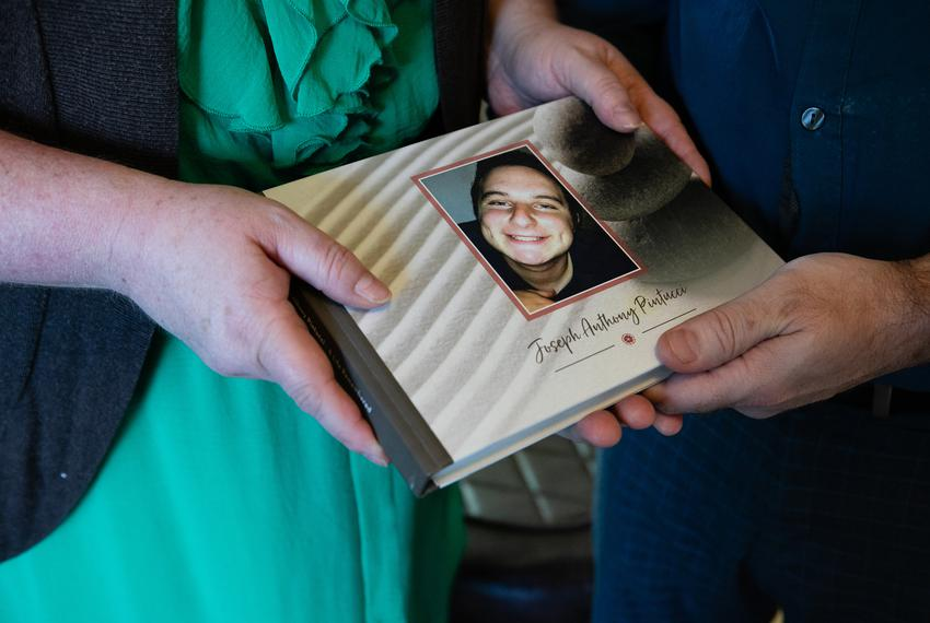 Andrea Haag and Ben Harrington, whose son Joseph Pintucci (pictured) was killed in January, pose for a portrait in their h...