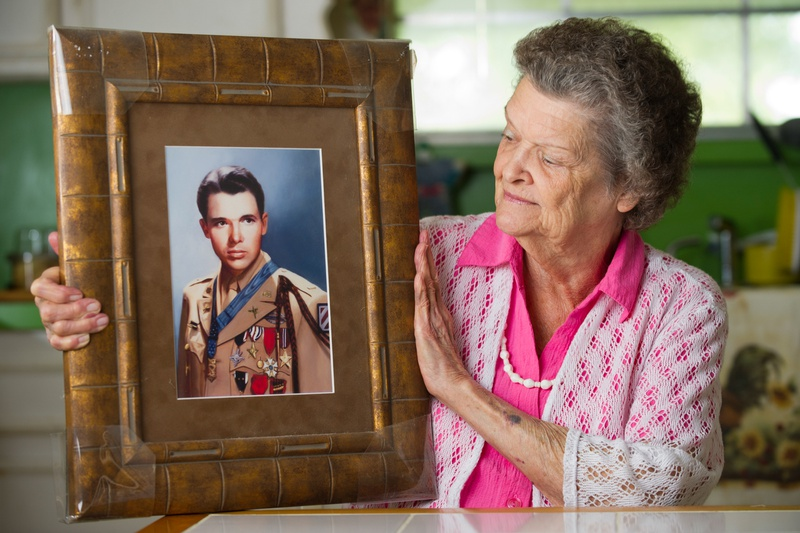 Nadene Lokey with a photo of her brother, WWII hero Audie Murphy, at her home in Farmersville, Texas on June 17, 2013.