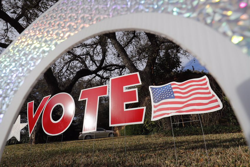"A ""vote"" sign in a yard in west Austin on March 6, 2018."