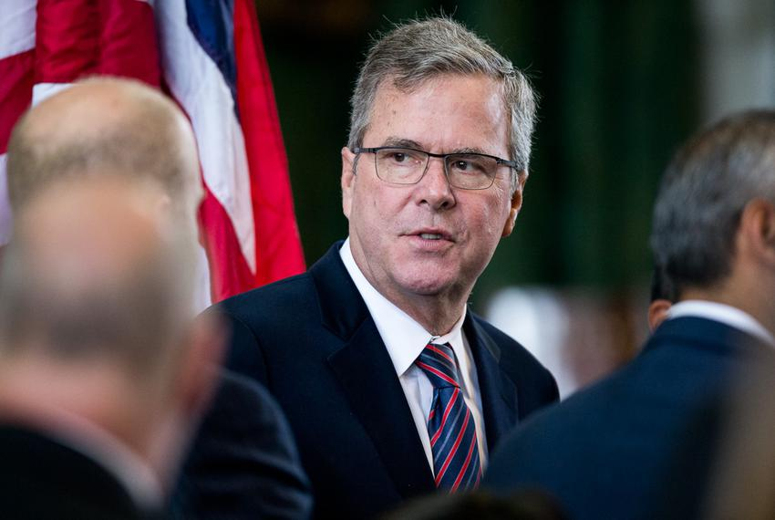 Former Florida Governor Jeb Bush visits with friends in the Texas Senate chamber after seeing his son George P. Bush, 38, ...