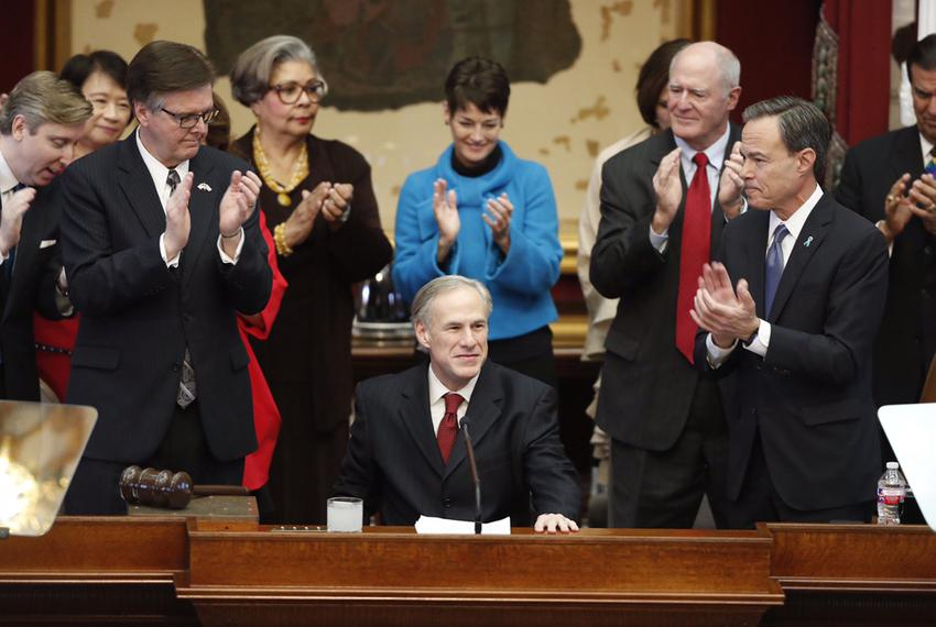Gov. Greg Abbott prepares to deliver his State of the State address, flanked by (l.-r.) Lt. Gov. Dan Patrick, state Rep. Sen…