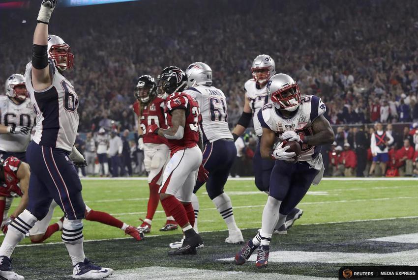 New England Patriots' James White (R) scores a touchdown in the fourth quarter against the Atlanta Falcons at Super Bowl LI …