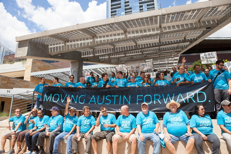 Austin Uber drivers participate in a rally against the proposal set by the Austin Transportation Department on Sept. 2, 2015.