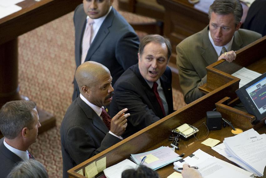 State Rep. Borris Miles (l), D-Houston, raises a point of order on HB400 the education bill sponsored by State Rep. Rob Eiss…
